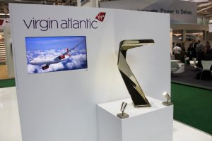 AIRCRAFT INTERIORS - Virgin Atlantic stool on display with complimentary video play