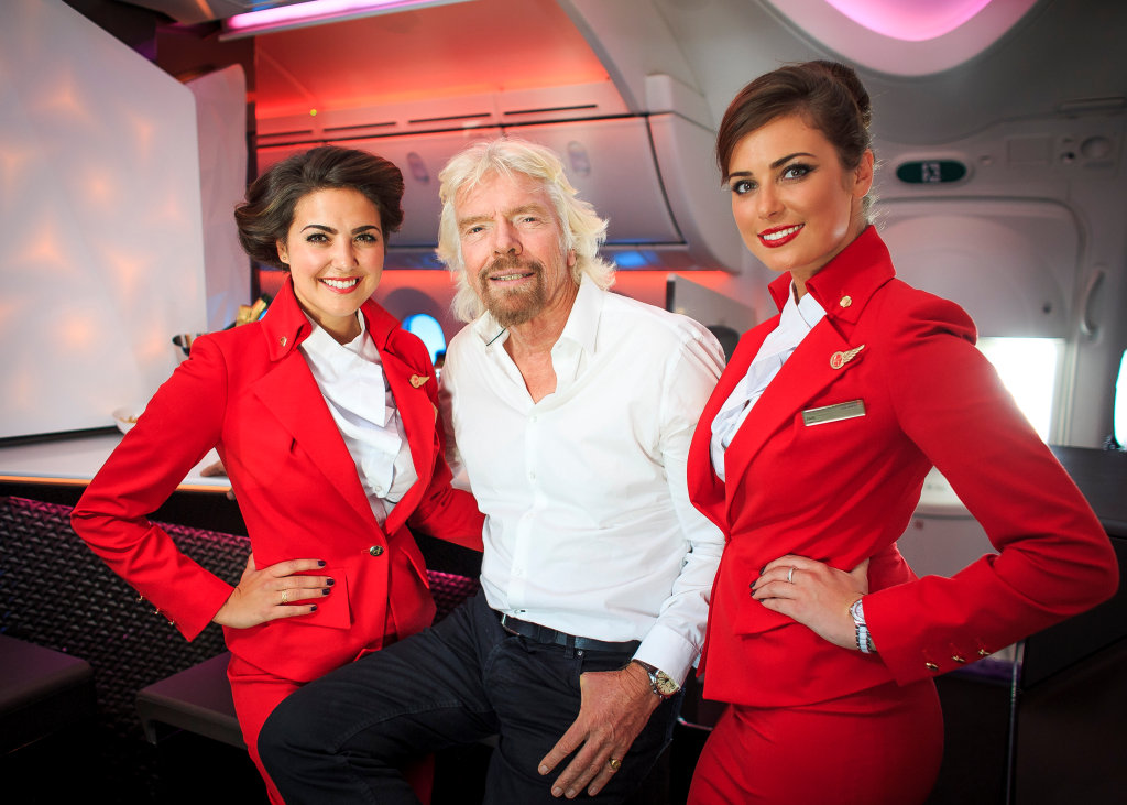 Richard Branson Virgin upper class bar with stewardesses